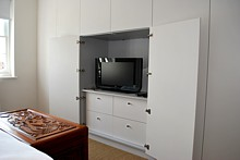Highly discreet and infinitely functional fitted wardrobes customised specifically for the space